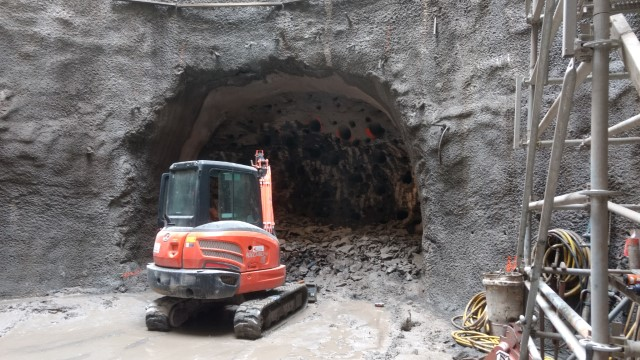 Rock breaking inside of the tail tunnel in preparation for the Tunnel Boring Machine (TBM) placement