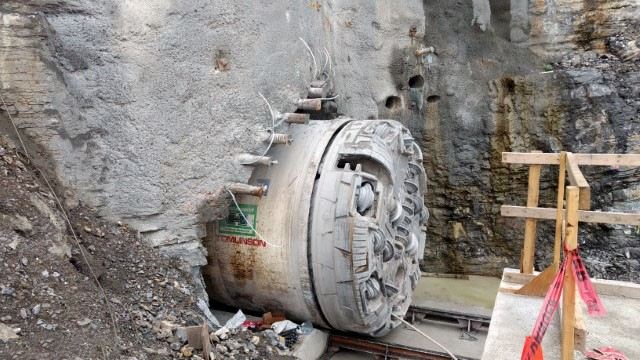 Side view of TBM moving through the exit portal.