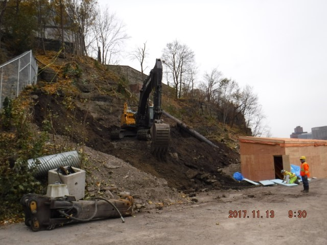 Excavation of the slope behind the Supreme Court of Canada to expose the rock face