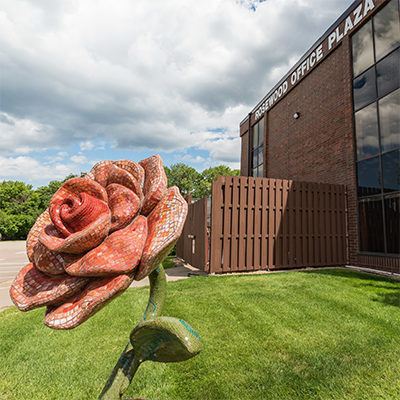 building exterior with rose sculpture